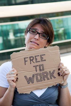 unemployed woman showing a message in a cardboard that she is free to work photo