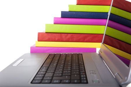 Colorful books next to a modern laptop Stock Photo - 5469884