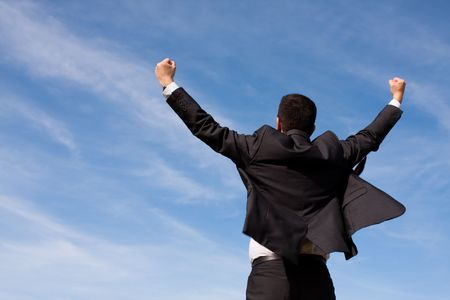 excited people: businessman showing his success at the field
