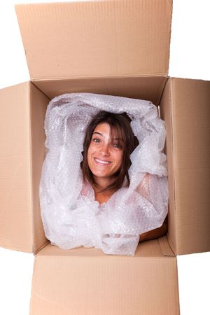 crowded space: woman face inside a cardboard box smiling