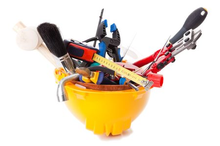 screwdriwer: a mix of construction tools over a white background (selective focus)