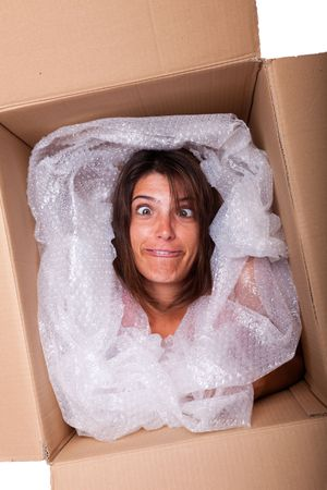 woman face inside a cardboard box smiling Stock Photo - 5585139