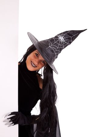 halloween witch holding a blank banner (isolated on white) photo