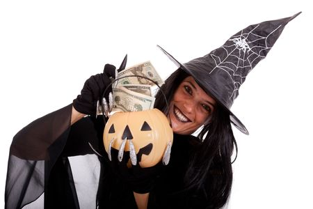 halloween witch saving money on her pumpkin photo