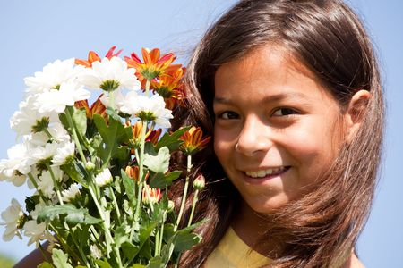 young female child holding a bouquet of red and white flowers (selective focus) Stock Photo - 5610540