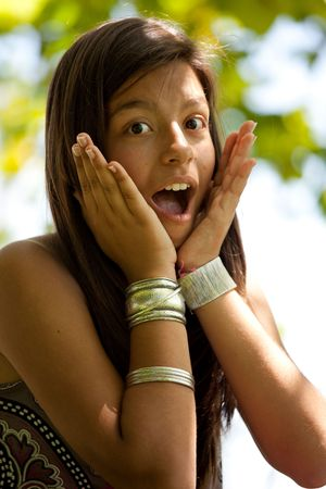 teen girl face: young girl surprise face at the park
