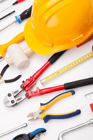 screwdriwer: a mix of construction tools over a white background