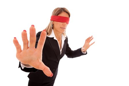 disoriented: blindfold businesswoman trying to find something (isolated on white)