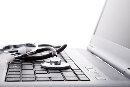 laptop with a stethoscope for good maintenance (selective focus) photo