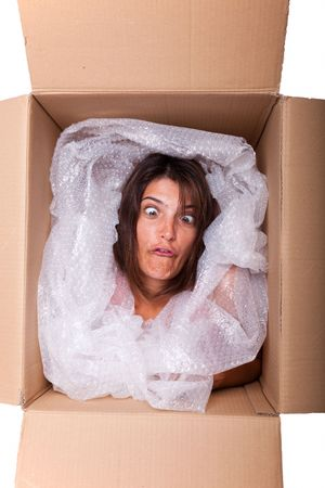 woman face inside a cardboard box smiling photo