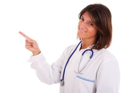 girl pointing: friendly woman doctor pointing to the copyspace (isolated on white) Stock Photo