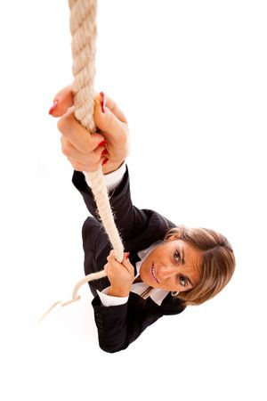 inconv�nient: businesswoman climbing up a rope (isolated on white) Banque d'images