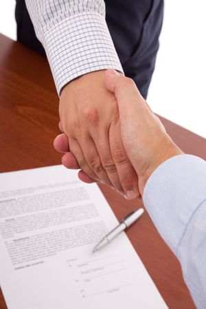 handshake between two businessman after closing the contract photo