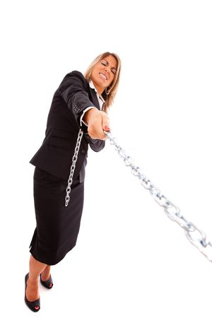 office slave: businesswoman pushing a chain (isolated on white) Stock Photo