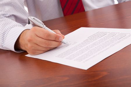 businessman at the office signing a contract photo