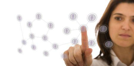 recursos humanos: empresaria de administrar su red de contactos, pulsando los botones de alta tecnolog�a en una pizarra (atenci�n selectiva) Foto de archivo