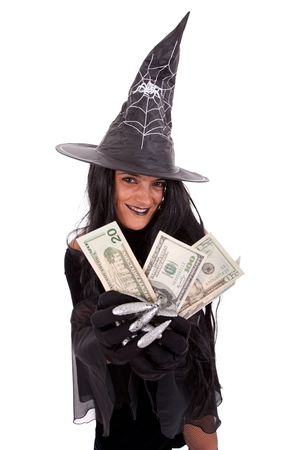 Halloween witch showing the money (isolated on white) photo