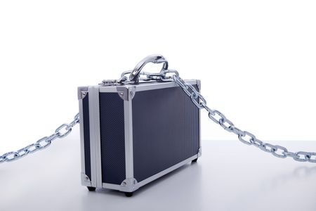 secret business briefcase locked with strong chain (selective focus) photo