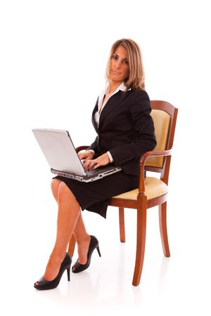 Businesswoman working with her laptop (isolated on white) Stock Photo - 5885642