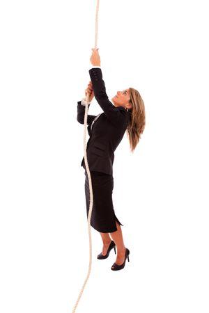 登る: (白で隔離される) ロープを登って実業家