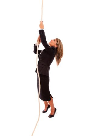 pulling rope: businesswoman climbing up a rope (isolated on white) Stock Photo