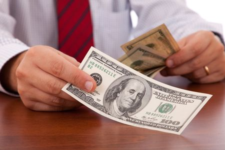 businessman at the office giving money Stock Photo - 5827092
