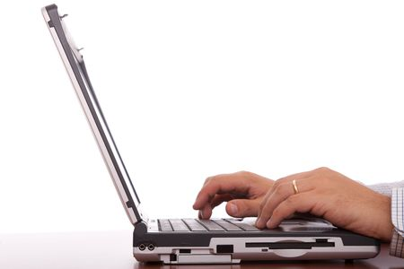 logon: businessman hands working with a laptop at the office