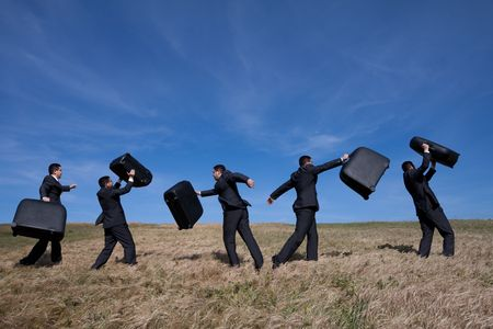 distant work: many businessman in the field walking with his luggage