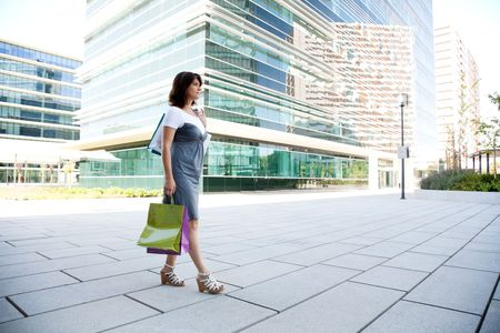 happy woman holding a lot of shopping bags photo