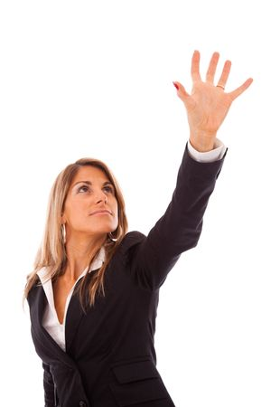 grabing: businesswoman trying to reach something with her hand Stock Photo
