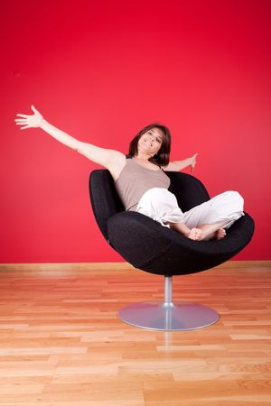 young woman enjoying her new house on her couch Stock Photo - 5887507