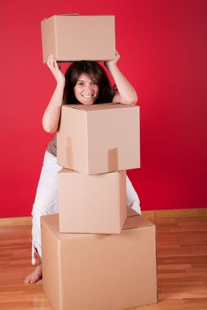 Young women next to cardboard boxes after moving house photo