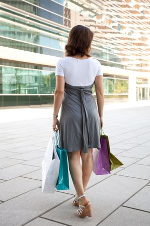 woman leaving the mall with shooping bags photo