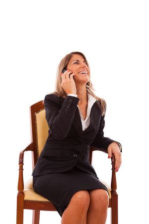Businesswoman talking at her cellphone (isolated on white) photo