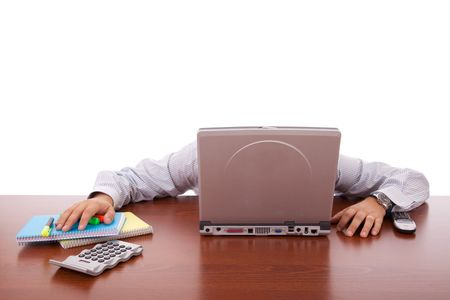 businessman sleeping behind his laptop photo