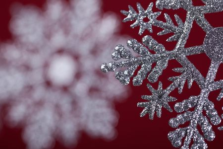 pending: background made of hanging christmas decoration over a red background (very shallow deep)