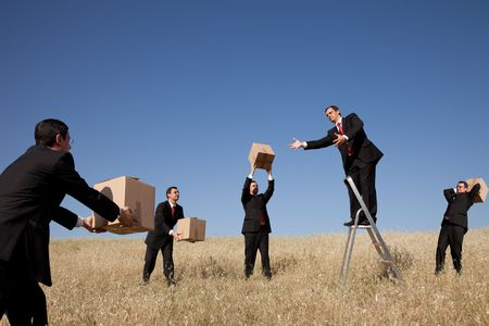 distant work: businessman in the field delivering a package Stock Photo