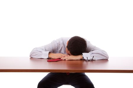 sleeping at desk: Businessman sleeping at the office (isolated on white) Stock Photo
