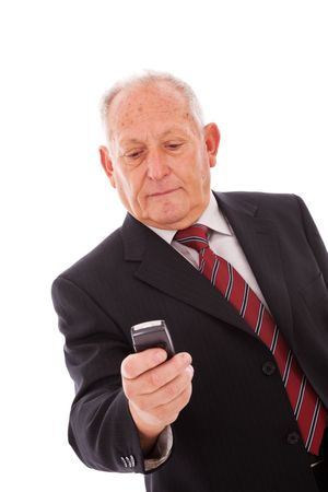 senior businessman sending a text message with his mobile phone Stock Photo - 5978952