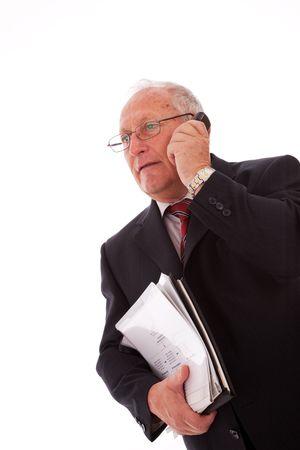 senior businessman talking on his cellular (isolated on white) Stock Photo - 6094030