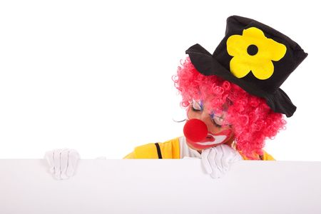 clown holding and looking to a blank banner (isolated on white) photo