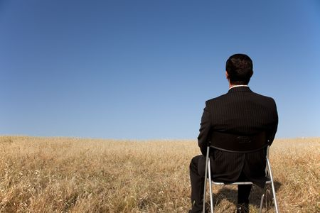 businessman sited in a chair looking to the landscape Stock Photo - 6317618