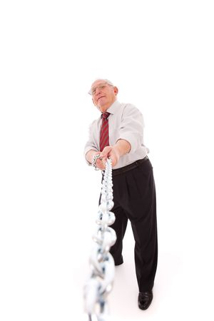 senior businessman pushing a chain (isolated on white) Stock Photo - 6317626