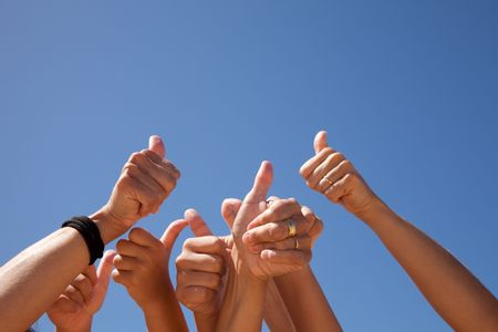 many hands raised to the blue sky (some motion blur) Stock Photo - 6353854