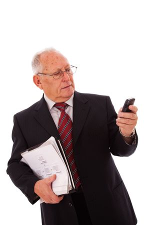 senior businessman talking on his cellular (isolated on white) photo