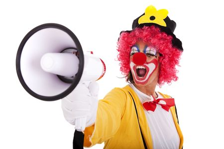 veselý: funny clown shouting at the megaphone (isolated on white)