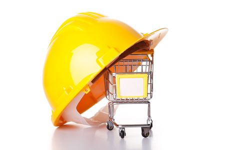construction helmet over a shopping cart (isolated on white) photo