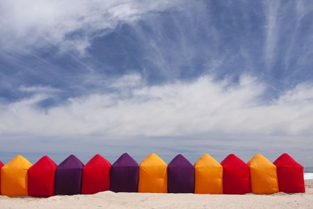 Colorful holiday beach tents and a blue sky Stock Photo - 6585409