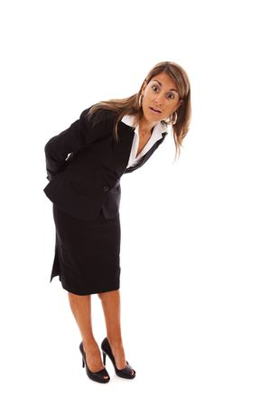 surprised face of a bending over businesswoman (isolated on white) photo