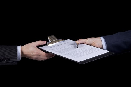 hands of two businessman passing some contract Stock Photo - 6952962